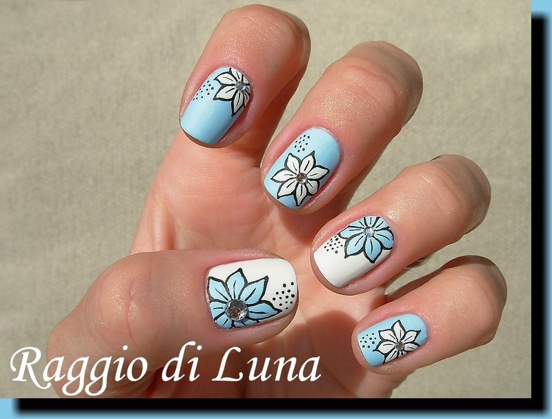 Flowers with silver rhinestones nail art by Tanja