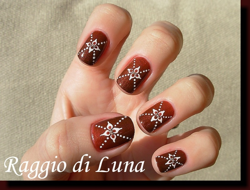 Little white flowers and dots on Enthralled nail art by Tanja