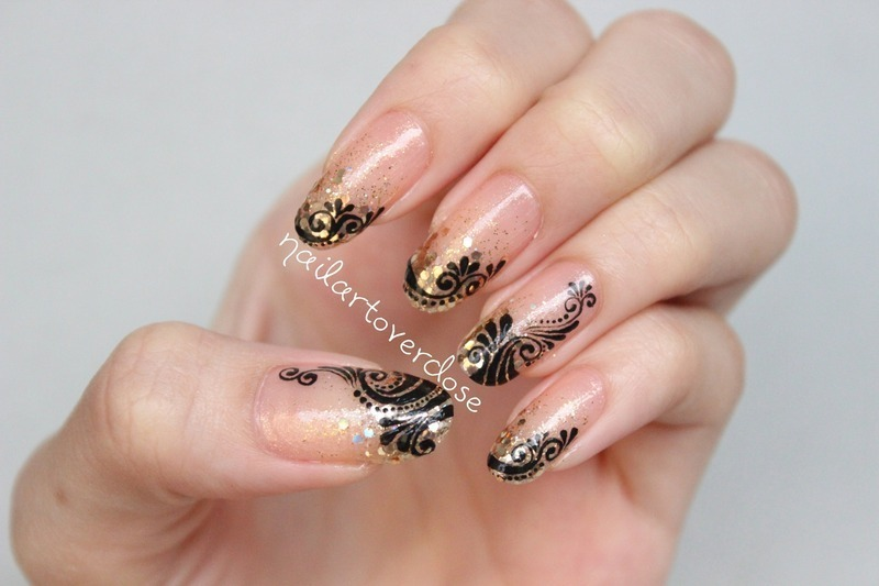Filigrees over gold glitter gradient nail art by nailartoverdose