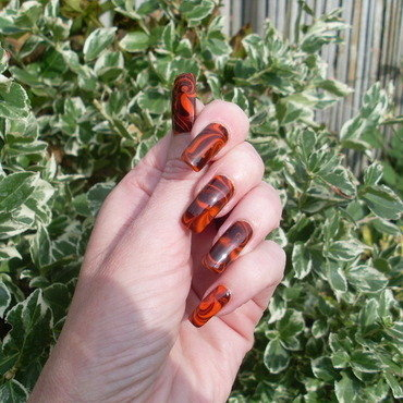 Black and orange water marble nail art by Tracey - Bite no more
