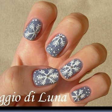 Snowflakes on textured blue denim nail art by Tanja