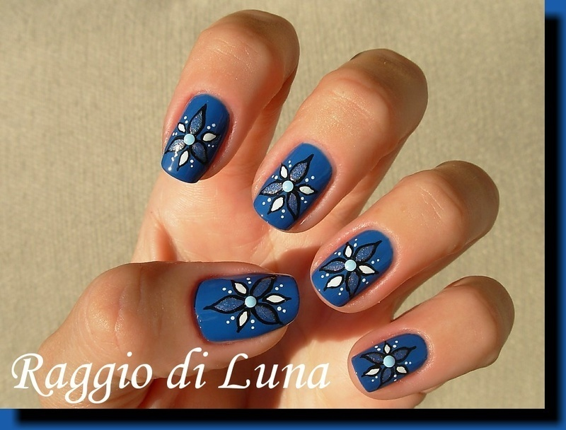 Flowers on gentian blue nail art by Tanja