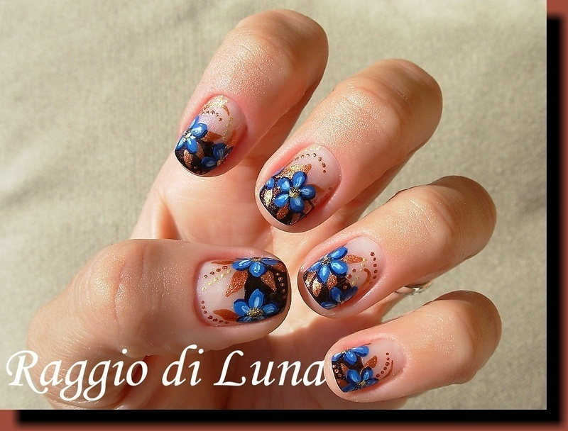 Brown french with blue flowers nail art by Tanja