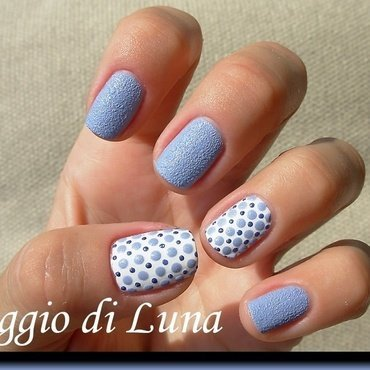 Textured blue dots on white nail art by Tanja
