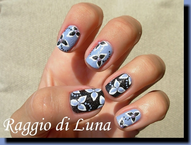 Textured flowers on textured nail art by Tanja