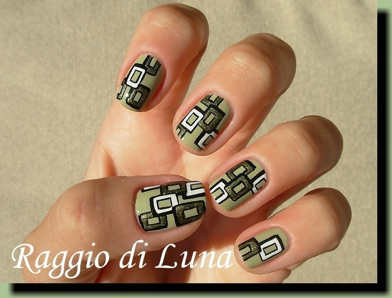 3D green & white squares on light green nail art by Tanja