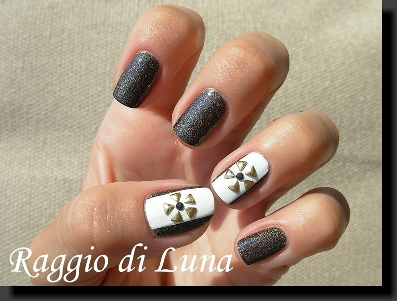 Golden triangle studs flower nail art by Tanja