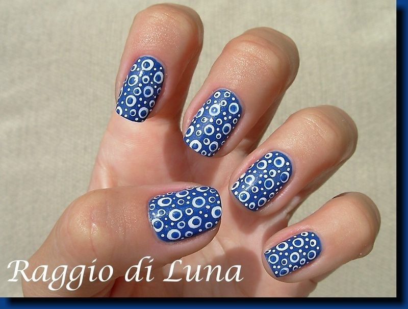 Crazy dots on blue nail art by Tanja