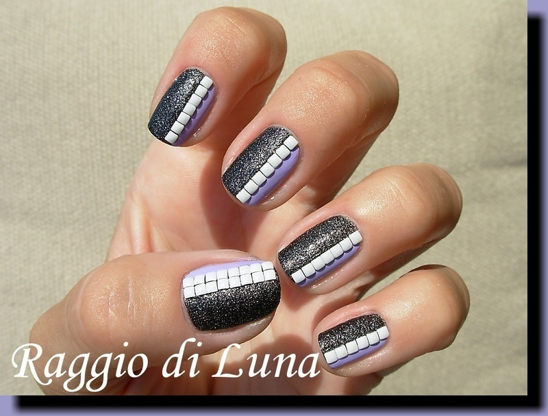 White square studs on black & light purple nail art by Tanja