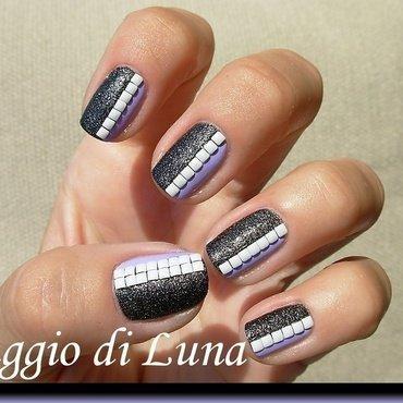 White square studs on black & light purple nail art by Tanja