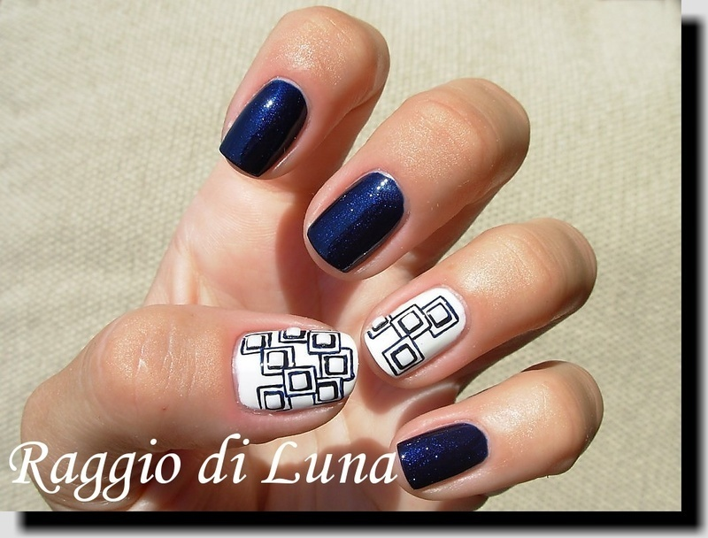 White square studs on dark blue squares nail art by Tanja