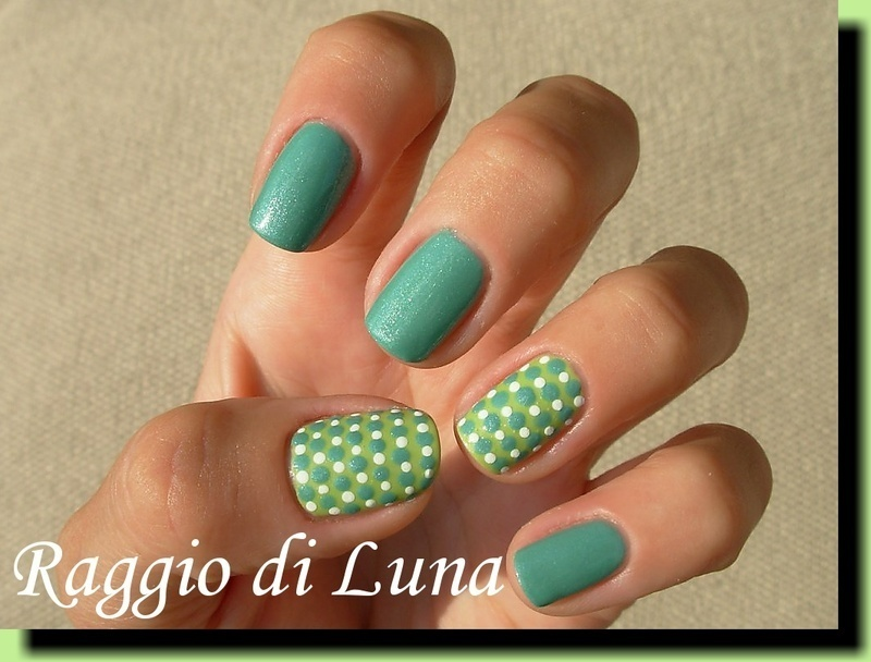 Green & white dots on light green nail art by Tanja