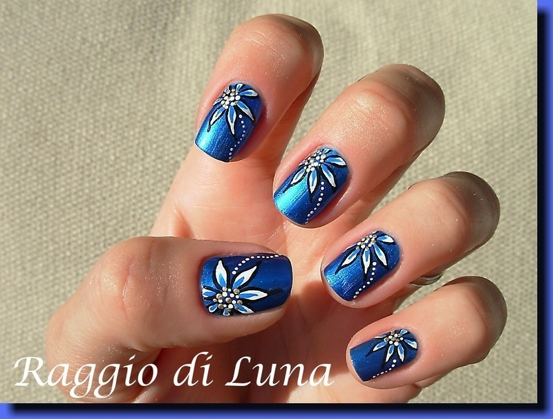 White and blue flowers on blue nail art by Tanja