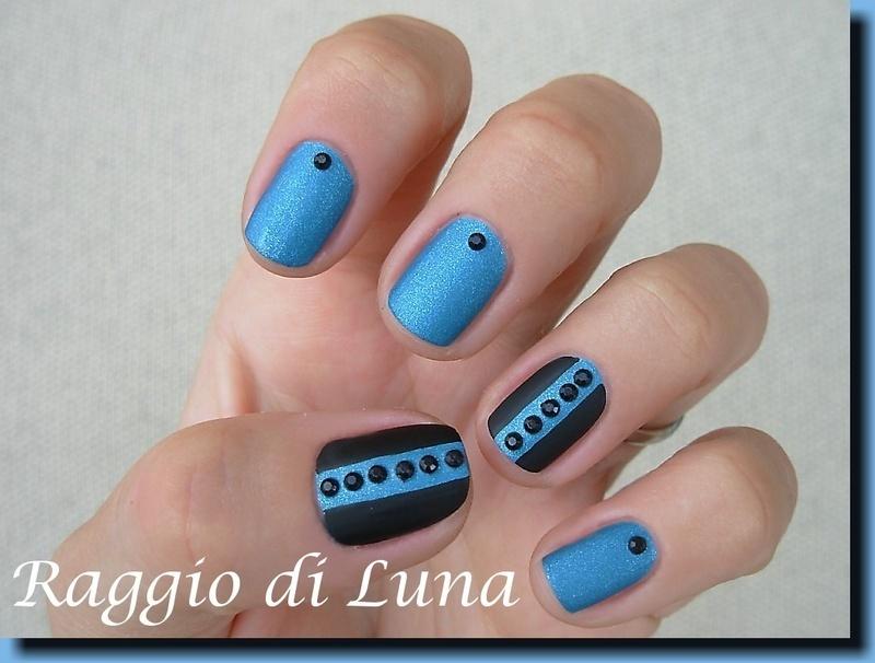 Black bottons on matt light blue nail art by Tanja