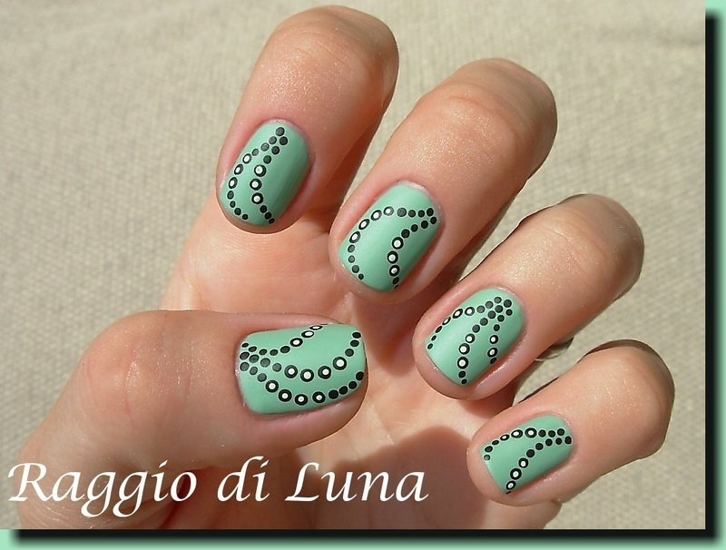 Black dots on matt green nail art by Tanja