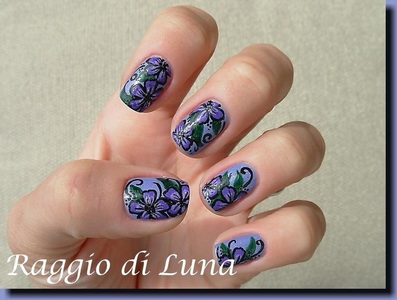 Purple flowers on light purple nail art by Tanja