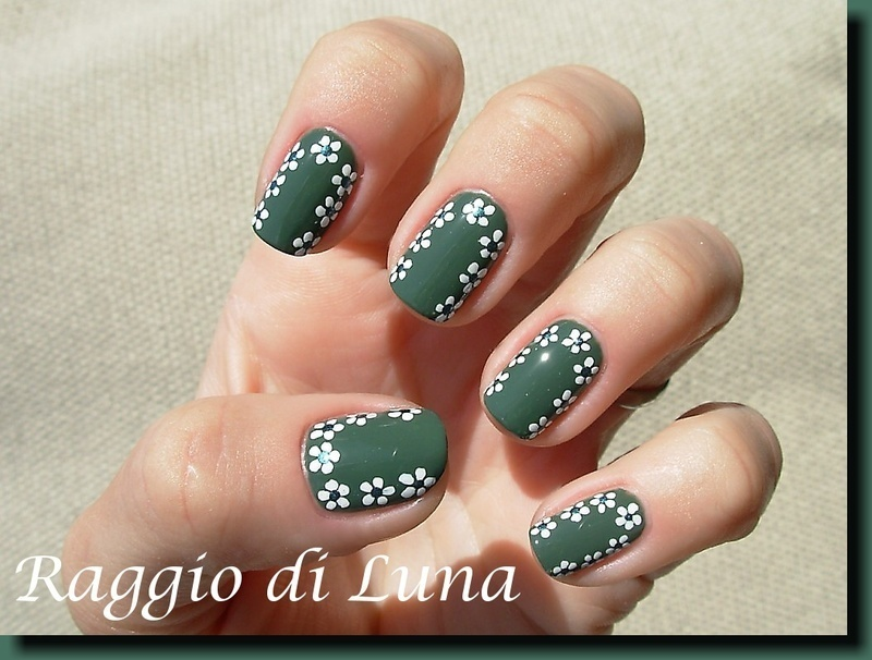 White dot flowers frame on green nail art by Tanja