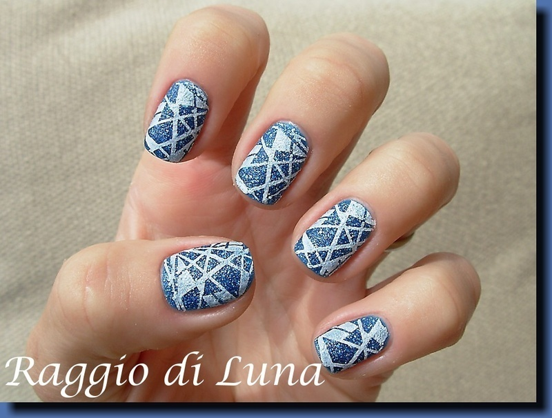 White stamping on blue liquid sand nail art by Tanja