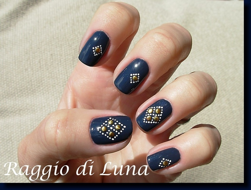 Golden coins on dark blue nail art by Tanja