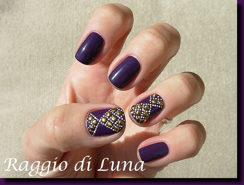 Golden coins on dark purple nail art by Tanja
