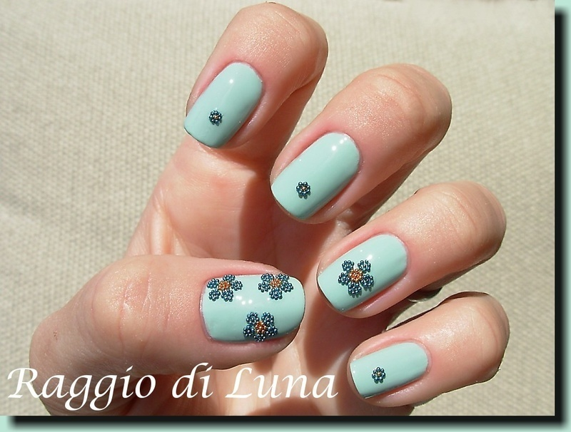 Bead flowers on jade green nail art by Tanja