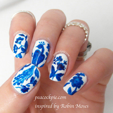 Delft Blue Peacock  nail art by Serra Clark