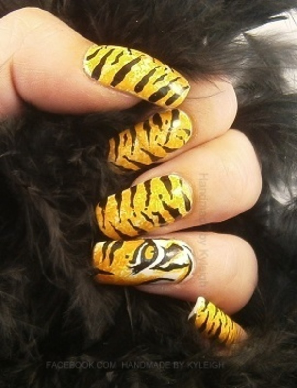Tiger Eye nail art by  Kyleigh  'Handmade By Kyleigh'