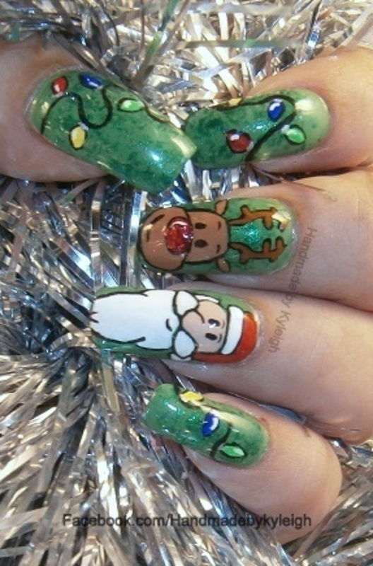 Santa and Rudolf nail art by  Kyleigh  'Handmade By Kyleigh'
