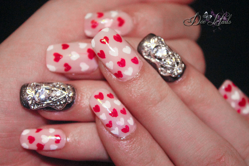 Heart pattern with metal accent nail art by Diana Livesay