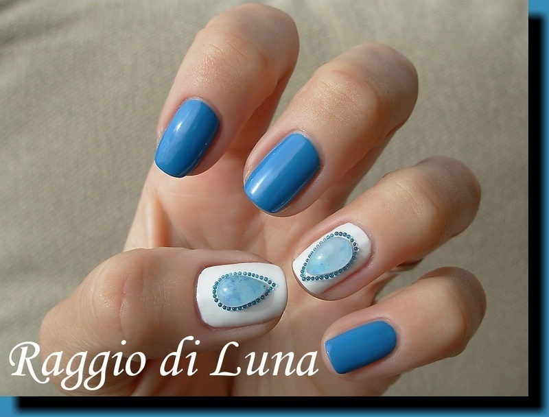Light blue tear with beads nail art by Tanja