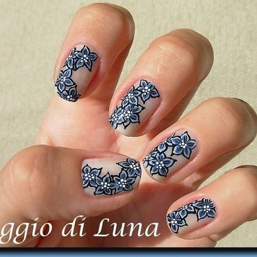 Blue flowers on nude nail art by Tanja