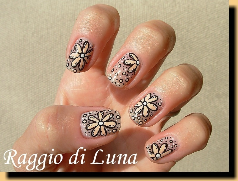 Creamy flowers on nude nail art by Tanja