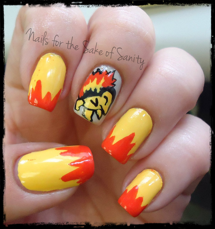 Cyndaquil nail art by Kelly Callahan