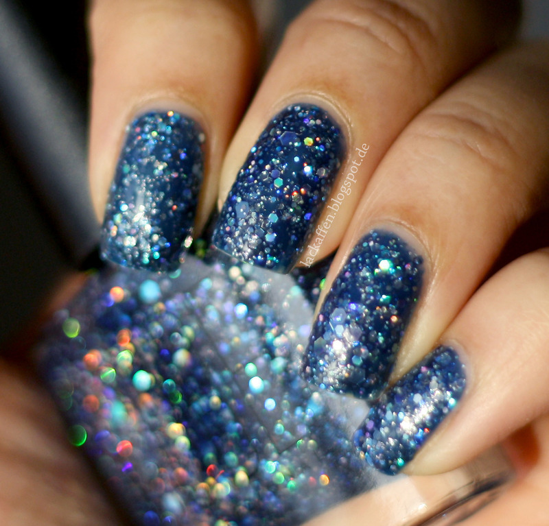 Instant Galaxy Nails nail art by Tartelette