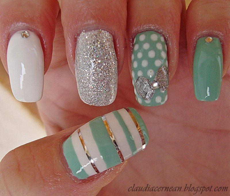 Silver Bow Nails nail art by Claudia