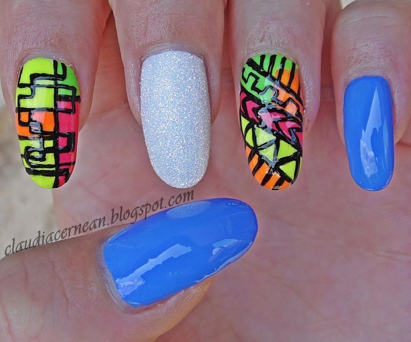 Colorful Tribal Nails nail art by Claudia