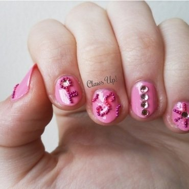 Think Pink nail art by Jacquie