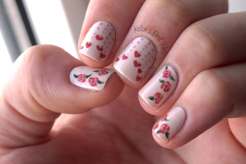 Hearts on Strings nail art by Kelsie