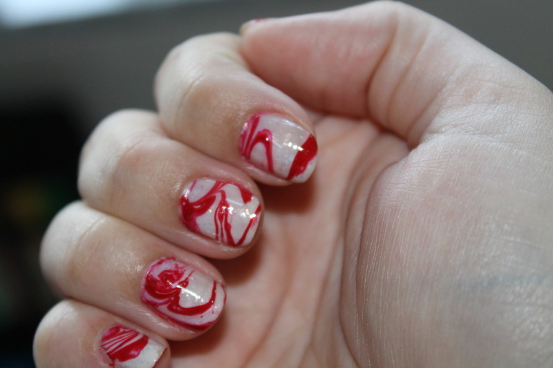 Candy Swirls Water Marble nail art by Kristy  Bond
