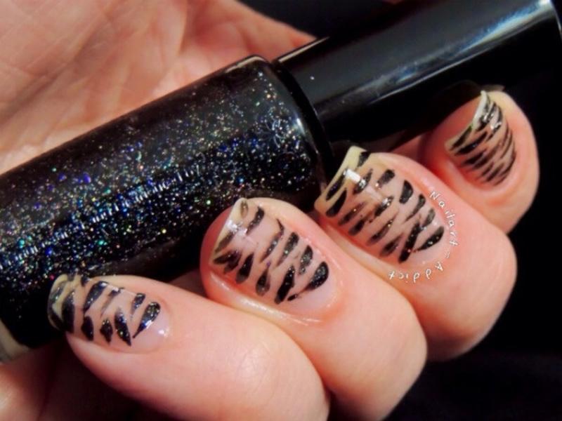 Almost bare tiger print nail art by Viv