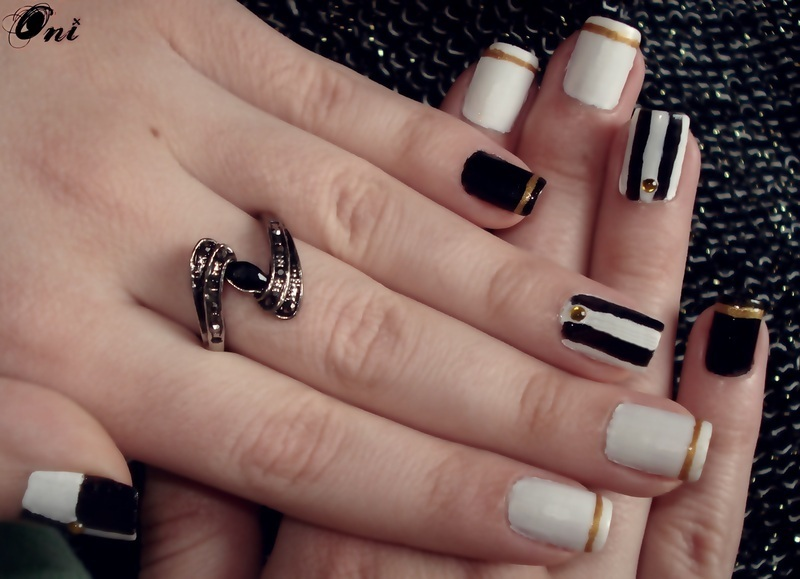 Black, white and gold nail art by Stegaru  Oana