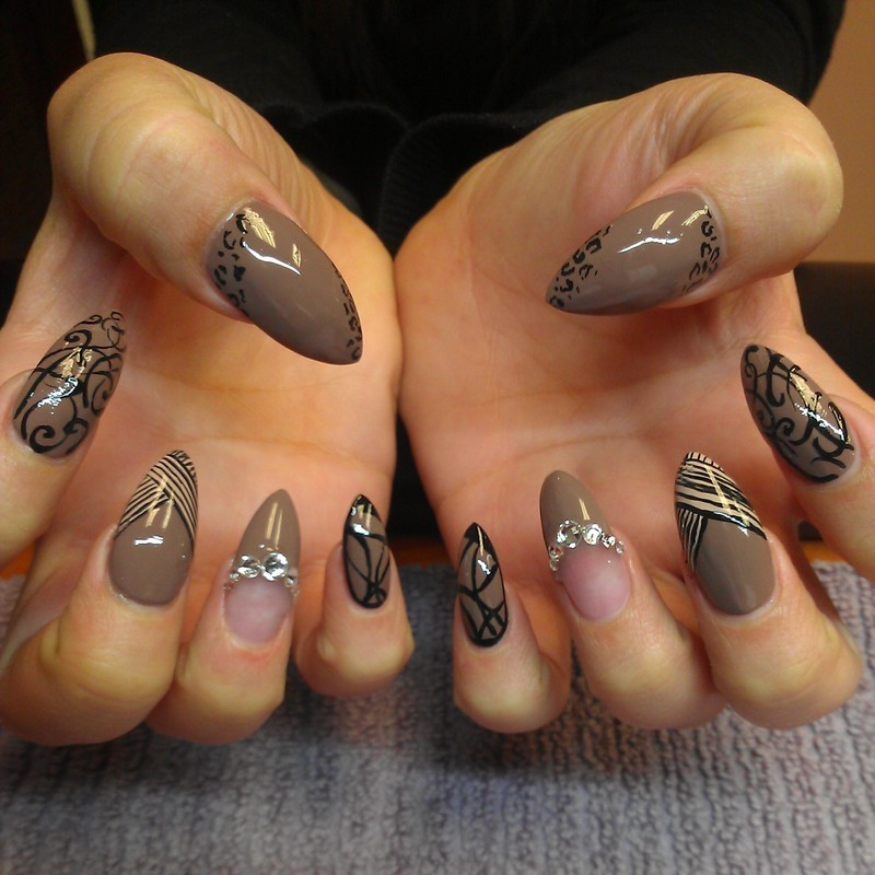 Mummified, with all her jewels and art... nail art by Sonia Garcia