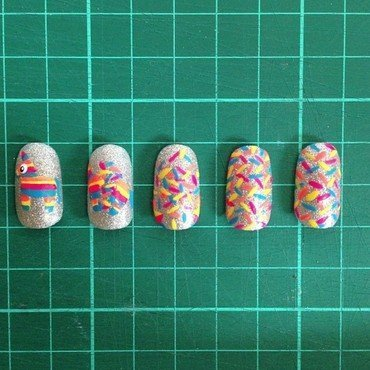The Exploding Pinata nail art by The Super Rad Nail Sisters