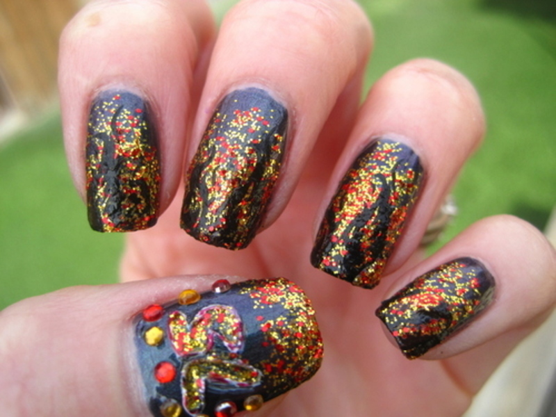 Hunger Games nail art by Donner