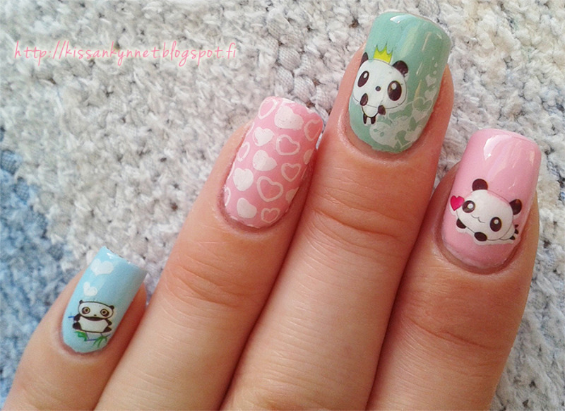 Hearts and pandas! nail art by Yue