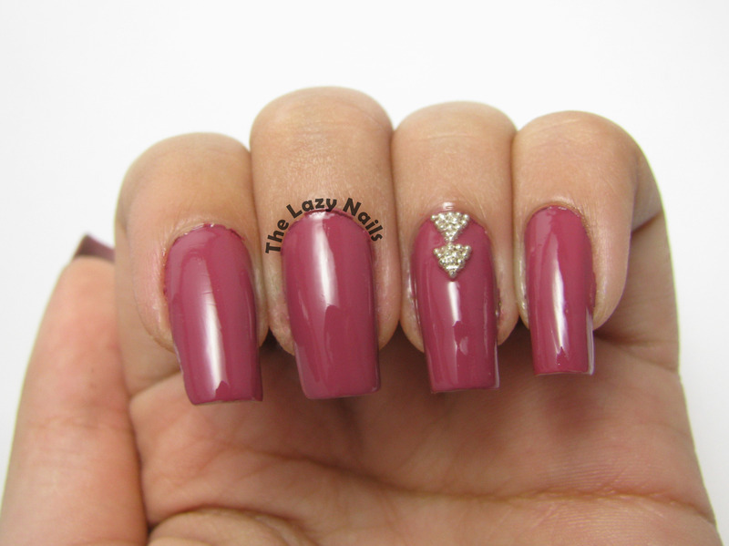 Triangle studs nail art by Hadas Drukker
