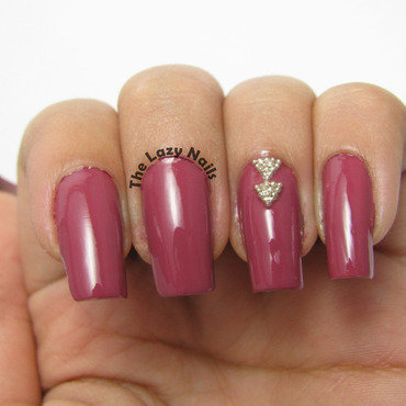Triangle studs nail art by Hadas Drukker