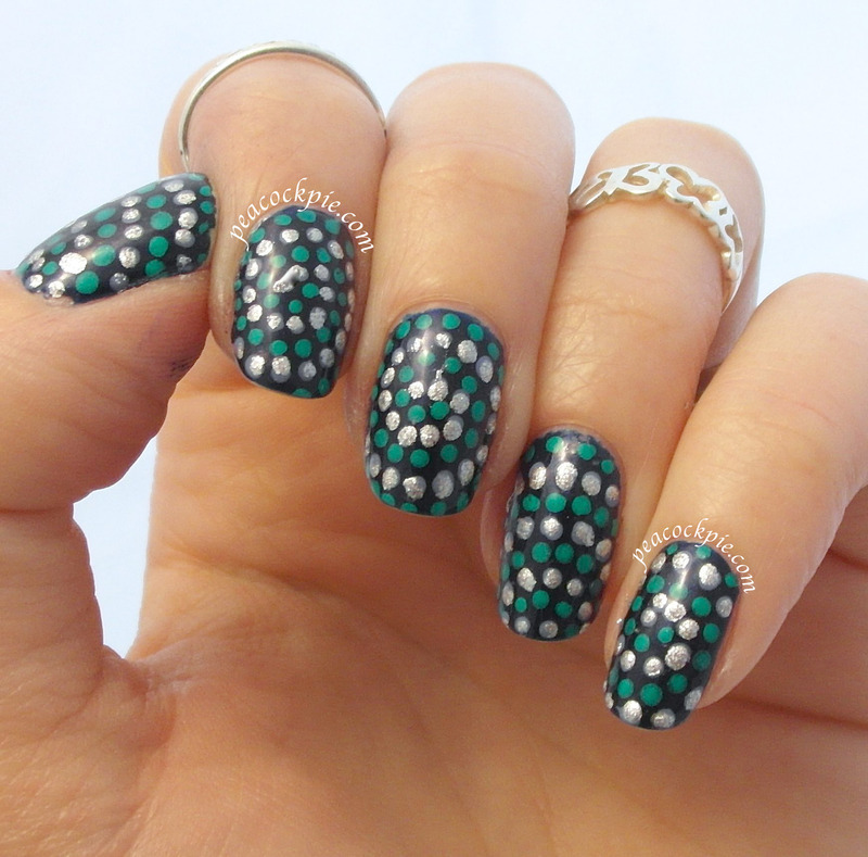 Dotted spirals inspired by Lucy's Stash nail art by Serra Clark