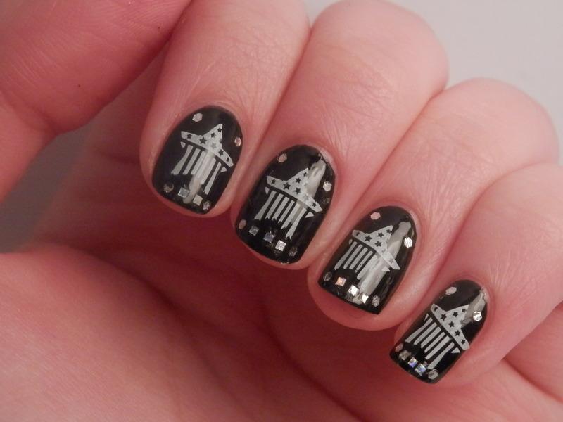 Black stars nail art by Enni