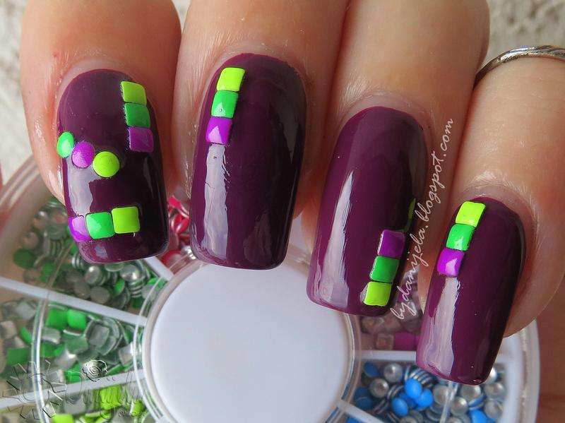 Plum with neon studs nail art by bydanijela